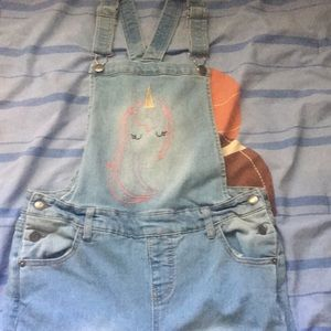 Unicorn blue jean overalls .